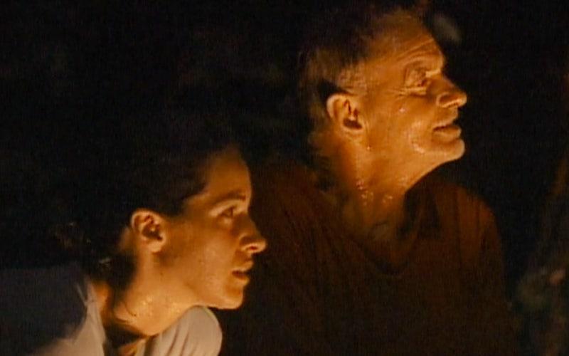 Stacey Stillman and Rudy Boesch watch Jeff Probst read votes during a downpour on Survivor: Borneo episode three.