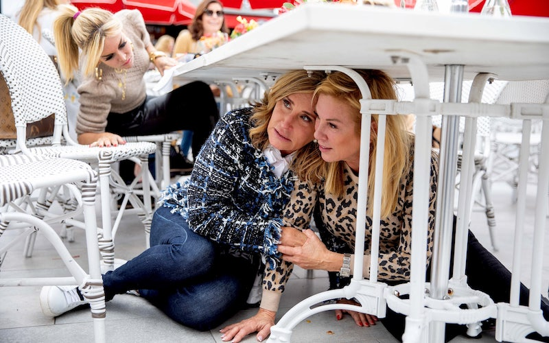 Tinsley Mortimer looks at Sonja Morgan and Ramona Singer under a table during The Real Housewives of New York City season 12, episode 9