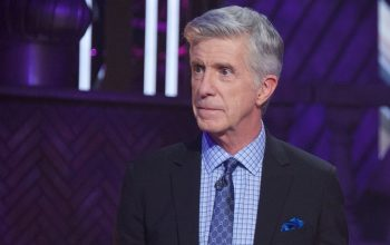 Tom Bergeron listens to the judges' critiques of Kate Flannery's performance during Dancing with the Stars 28's Disney episode.