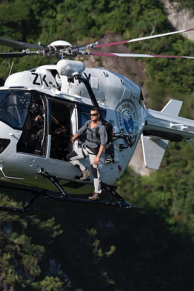 Bear Grylls' hosting of Eco-Challenge involves lots of grandstanding, such as standing on the side of helicopters