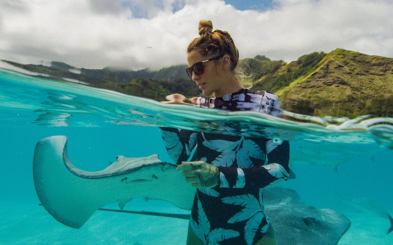 Marine biologist Kori Garza with stingrays on the Sharkfest special World's Biggest Tiger Shark