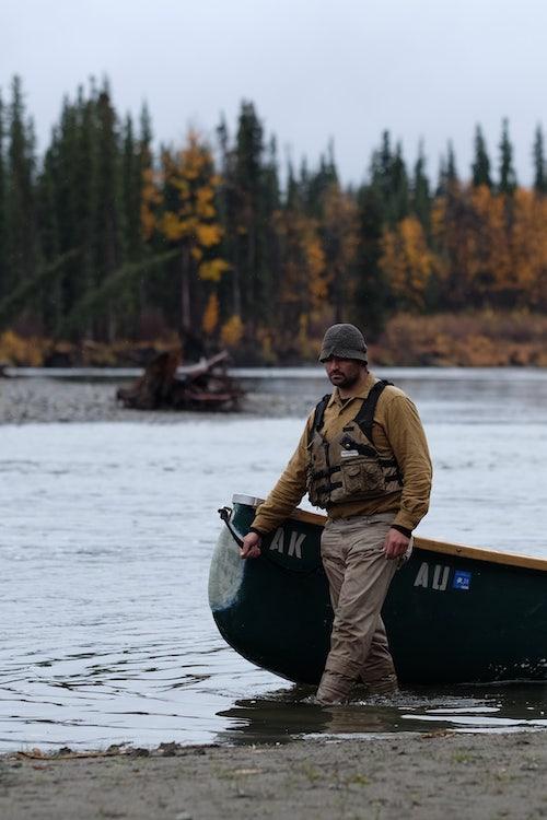 Life Below Zero: Next Generation star Michael Manzo with a canoe on the Gulkana River in Alaska
