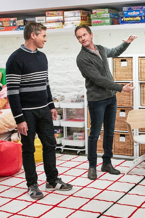 David Burtka and Neil Patrick Harris in their organized playroom, with games and Lego organized by color