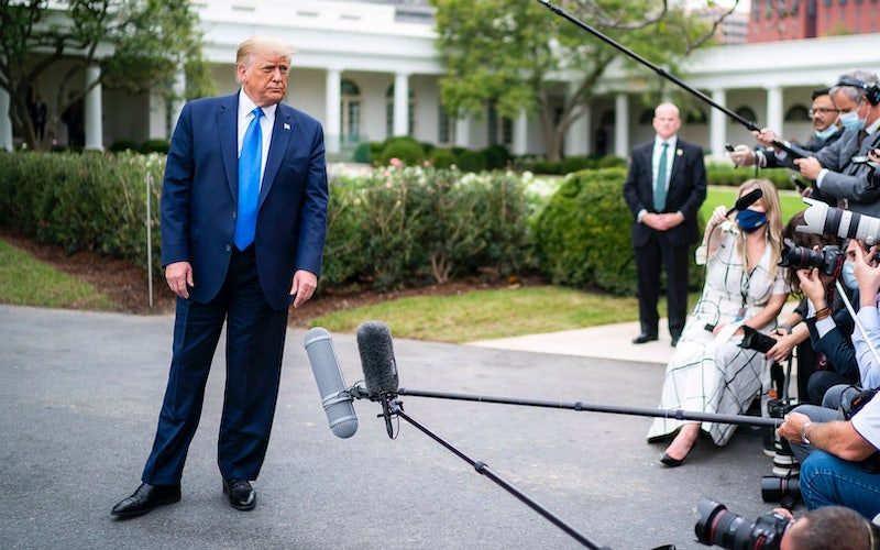 President Donald Trump talks to the media on Thursday, Sept. 24, before traveling to North Carolina and Florida