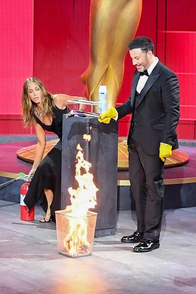 Jennifer Aniston and Jimmy Kimmel moments before she put out a fire, again, during the 2020 Primetime Emmy Awards