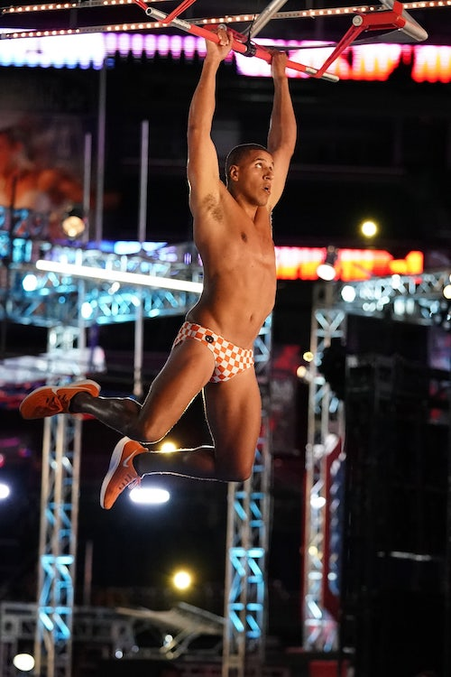 Mike Wright during the qualifying round of American Ninja Warrior season 12, navigating the obstacle Slingshot, which was introduced last season