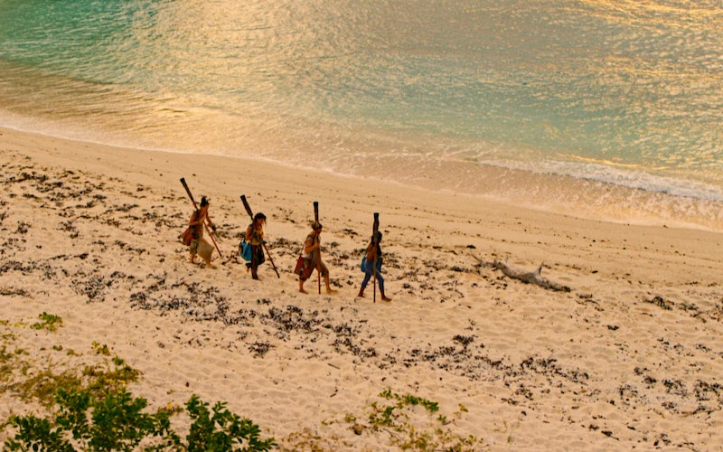 Survivor: Winners at War's final four—Sarah Lacina, Michele Fitzgerald, Tony Vlachos, and Natalie Anderson—walking on the beach in Fiji on the season finale. They'll likely be the last Survivor contestants to walk there until 2021