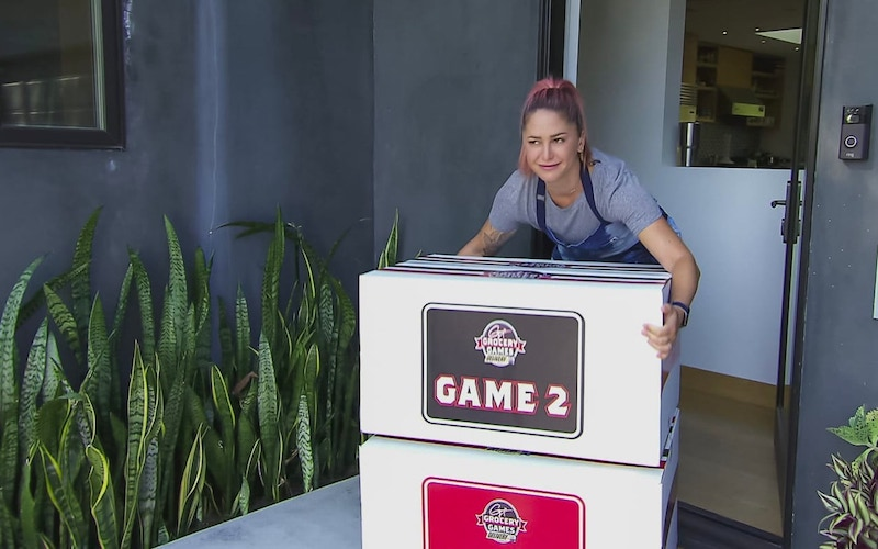 Brooke Williamson retrieves boxes of groceries on Guy's Grocery Games: Delivery
