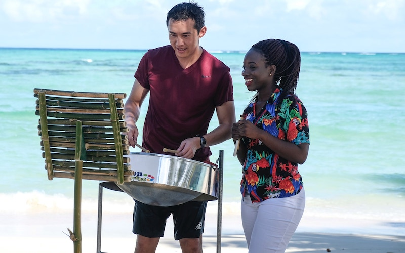 Chee Lee learns how to play a steel pan on The Amazing Race 32 episode 1