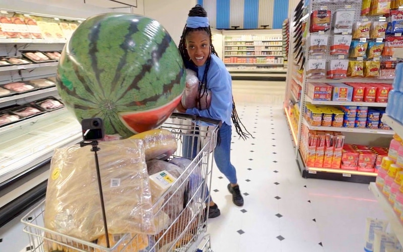 Supermarket Sweep contestant Jaleah Wilder with an inflatable bonus prize in her cart