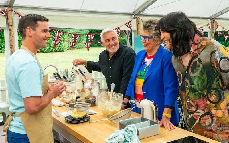 Dave Friday, judges Paul Hollywood and Prue Leith, and host Noel Fielding during The Great British Baking Show season 11, Netflix collection 7, episode 1: cake week