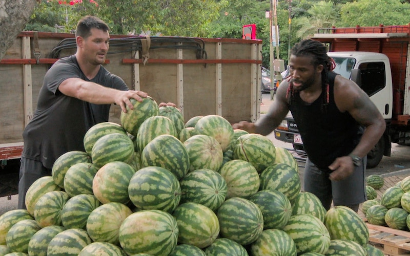 Gary Barnidge and DeAngelo Williams attempt to create a pyramid out of watermelons