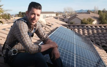 Jonathan Scott with some solar panels on Jonathan Scott's Power Trip, a documentary about renewable energy