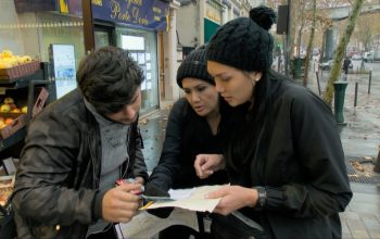 Michelle Newland and Victoria Newland ask for directions in Paris, France