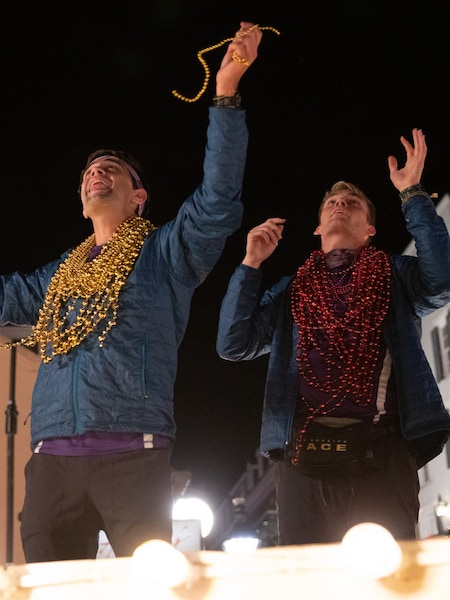 James Wallington and Will Jardell catch beads on Bourbon Street in New Orleans on The Amazing Race 32 finale