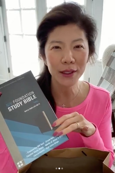 A screenshot of an Instagram video in which Julie Chen Moonves shows the Bible that she's giving away to fans—and gave to at least one BB22 cast member.