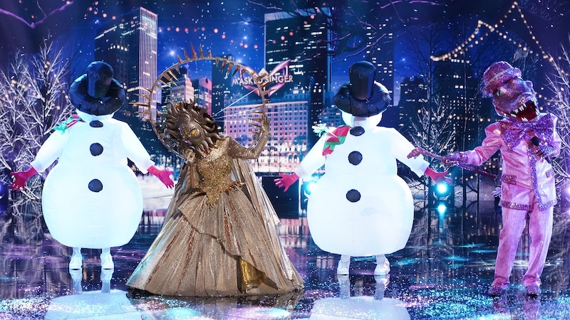 Sun and Crocodile performing during The Masked Singer season 4 finale