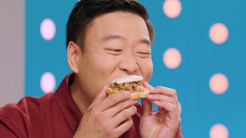 Best Leftovers Ever! judge David So tastes a contestants' food during episode 3