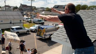 Robert Irvine throws furniture onto the ground during the 2013
