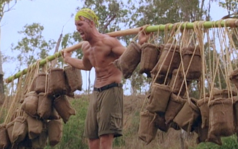 Colby Donaldson holds 400 pounds of water during the Survivor: The Australian Outback episode 3 reward challenge