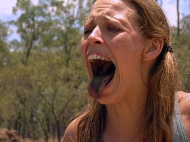 Kimmi Kappenberg shows Jeff Probst she's successfully eaten a worm during the Survivor: The Australian Outback episode 2 immunity challenge