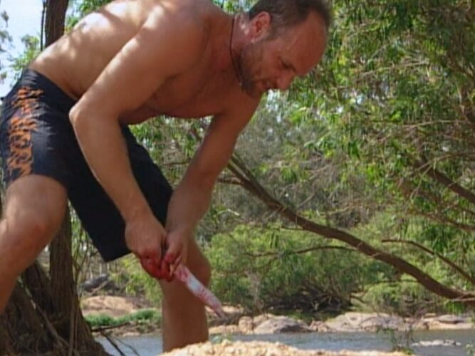 Michael Skupin stabbing a pig, which the camera operator kept out of the frame, during Survivor: The Australian Outback episode 4