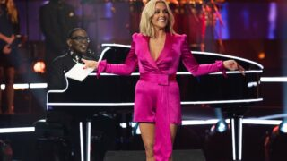 Name That Tune band leader Randy Jackson and host Jane Krakowski in the premiere episode