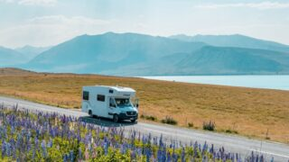 An RV, kind of like the one from Road Rules, in front of Lake Tekapo in New Zealand