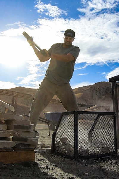 Scott Henry smashes stones during the opening challenge of Tough As Nails season 2