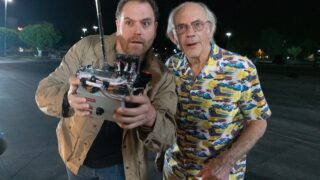 Josh Gates and Christopher Lloyd search for a DeLorean on Expedition: Back to the Future