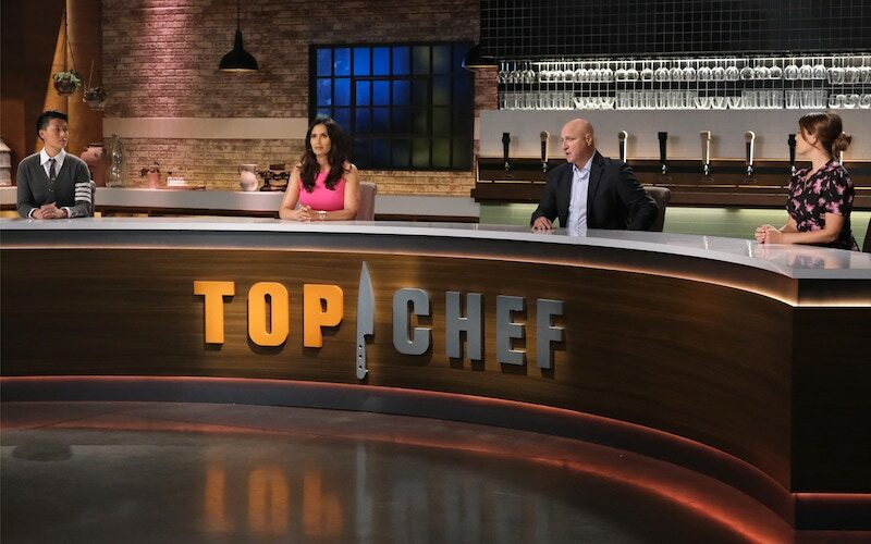 Melissa King, Padma Lakshmi, Tom Colicchio, and Gail Simmons at the massive judges' table during episode 1 of Top Chef Portland
