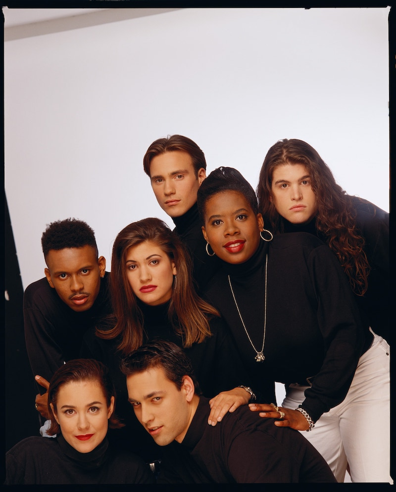 The Real World season 1 cast in 1992: Becky Blasband, Andre Comeau, Heather B. Gardner, Julie Gentry, Norman Korpi, Eric Nies, and Kevin Powell