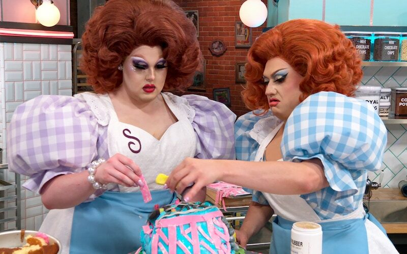 """Nailed It: Double Trouble contestants Selma Nilla and Lagoona Bloo work on their rollercoaster cake in the """"The Burbank State Fair"""" episode of season 5"""