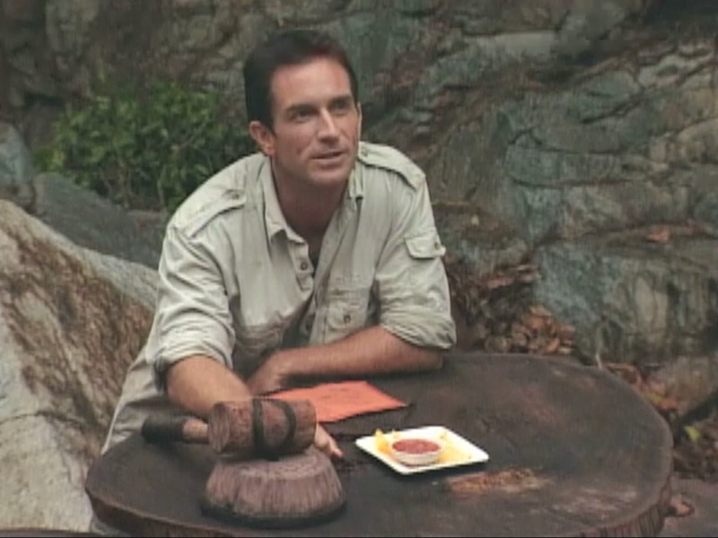 Jeff Probst with the very first Survivor auction item ever: four chips and salsa