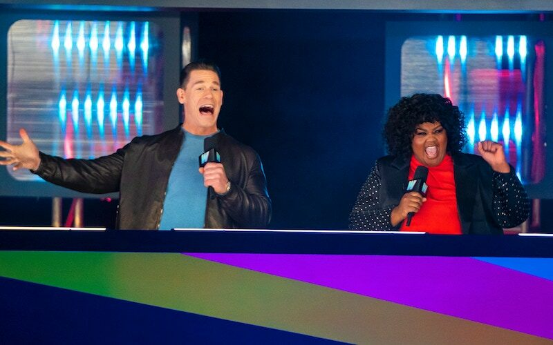 John Cena and Nicole Byer hosting Wipeout, during the one part of the show where they actually seem to be reacting to what's happening in front of them.