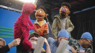 Sesame Street puppeteers operate Elmo and new muppets Elijah and Wes Walker during the documentary Sesame Street: 50 Years of Sunny Days