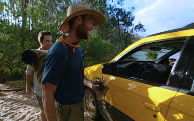 Colby Donaldson inspects the Pontiac Aztec he won during the Survivor: The Australian Outback's final reward challenge. That win began Survivor's car curse, which was never broken.