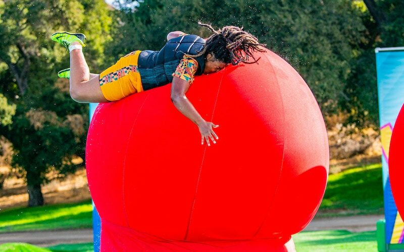 A Wipeout contestant faceplants on the new big red balls