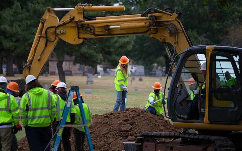At Tulsa's Oaklawn Cemetery on Oct. 2, 2020, forensic archeologists excavate an area they suspect to be a mass grave