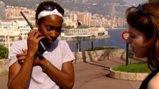Afi and Kathryn radio other players from a castle in Monaco on The Mole season 1, episode 2