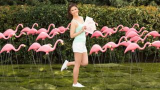 BB23 host Julie Chen and plastic flamingos photographed for Big Brother 23