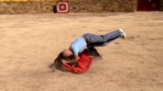Charlie gets knocked over by a bull in Spain on The Mole season 1, episode 3