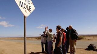 The Mole season 1's cast in episode 1, watching helicopters arrive in the Mojave Desert