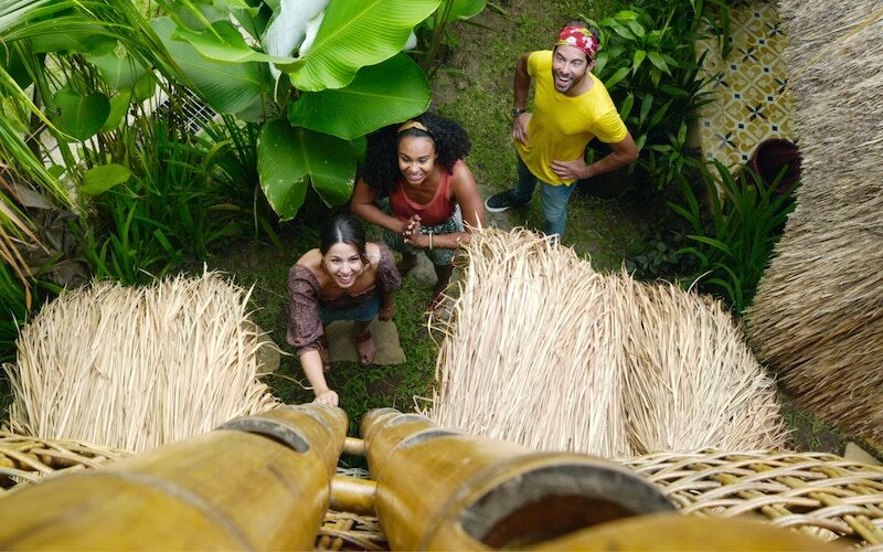 Megan, Jo, and Luis look up at a treehouse room at a modern hostel in Bali on World's Most Amazing Vacation Rentals