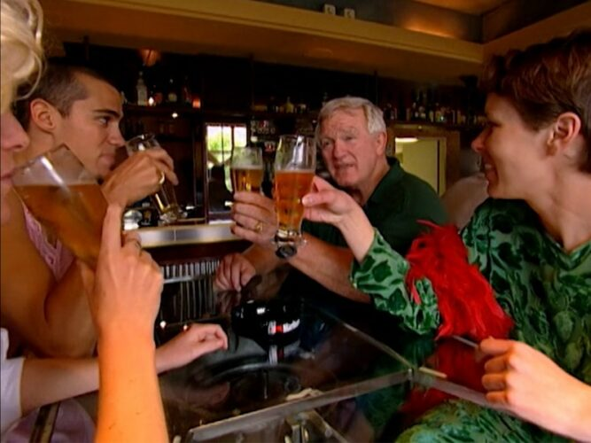 Ali, Bribs, Bill, and Lisa have a drink while the other Mole 2 players worry that they'll miss their train.