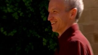 Anderson Cooper grins as The Mole season 1 players are reunited with their family members during episode 5.