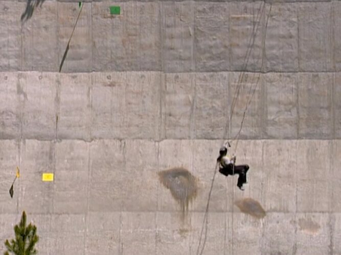 On The Mole 2, episode 4, Heather rappels down a dam, and tries to reach questions, which are the small yellow and green squares visible here.