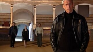Anderson Cooper stands in a bull-fighting ring as the final three Mole players—Jim, Kathryn, and Steven—enter for their final test.
