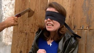 Even after fainting, Kathryn goes through with the knife-throwing challenge on The Mole season 1, episode 7