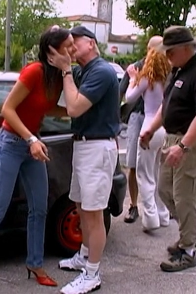Patrick kisses one of the two women who asked The Mole 2's players for help changing a tire.
